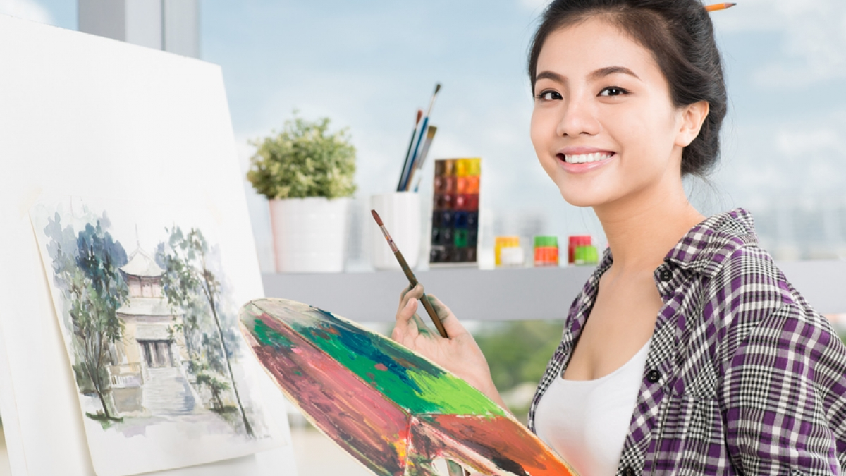 Smiling artist with paintbrush